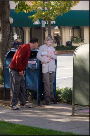 Breastfeeding against mailbox